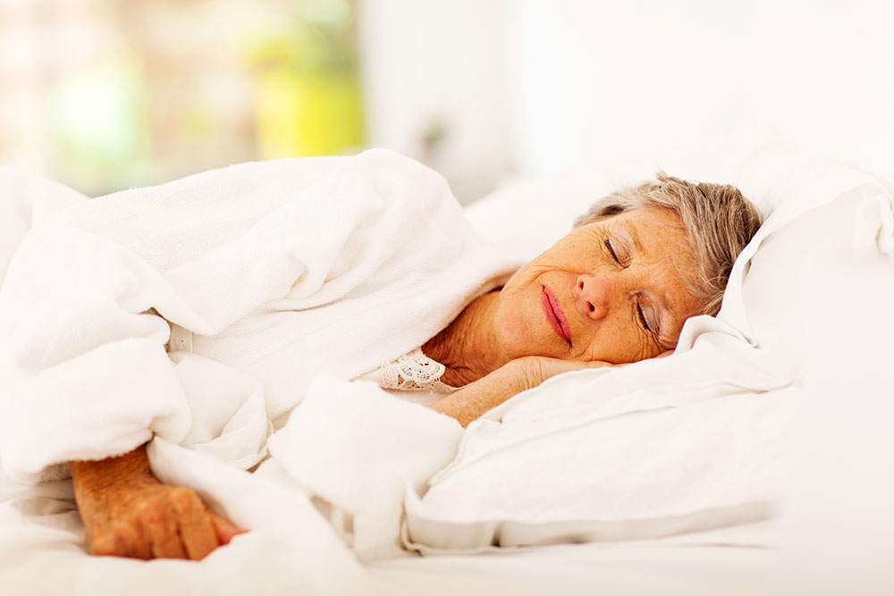 woman with incontinence supplies sleeping well